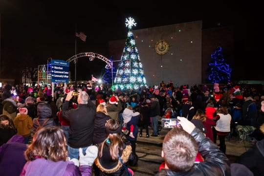 Spectators fill Huron Avenue and the plaza in front of McMorran for the annual Christmas tree lighting following the 2019 Sperry's Santa Claus Parade Friday, Nov. 29, 2019, in downtown Port Huron.