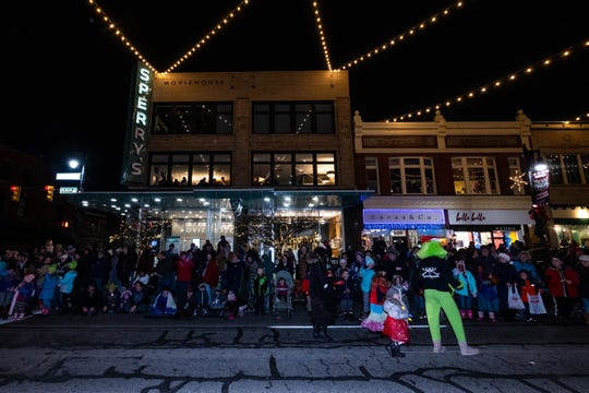 Spectators line Huron Avenue for the 2019 Sperry's Santa Claus Parade Friday, Nov. 29, 2019, in downtown Port Huron.