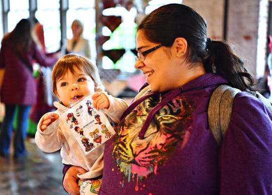 Dannielle Hoffacker, right, and her nearly one-year-old daughter, Lily, both of York City, during Merry Market at the Bond on Small Business Saturday at Royal Square in York City, Saturday, Nov. 30, 2019. Lily will celebrate her first birthday on Dec. 4. Dawn J. Sagert photo
