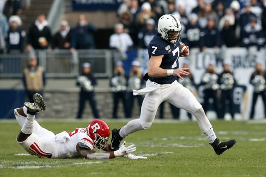 Nov 30, 2019; University Park, PA, USA; Penn State Nittany Lions quarterback Will Levis (7) avoids a tackle while running with the ball during the first quarter against the Rutgers Scarlet Knights at Beaver Stadium. Mandatory Credit: Matthew O'Haren-USA TODAY Sports