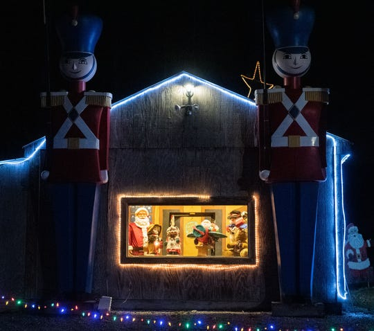 Onlookers can spot Santa's workshop at Donald Webb's public Christmas display, November 29, 2019.