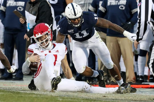 Nov 30, 2019; University Park, PA, USA; Rutgers Scarlet Knights quarterback Johnny Langan (17) is tackled by Penn State Nittany Lions linebacker Micah Parsons (11) during the second quarter at Beaver Stadium. Mandatory Credit: Matthew O'Haren-USA TODAY Sports