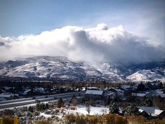 Storm clouds roll over a snowy mountain in Reno on Nov. 27, 2019.