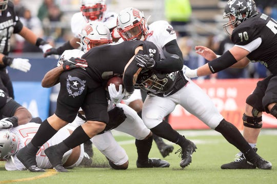 Nevada running back Toa Taua is stuffed by the UNLV defense during Saturday's game at Mackay Stadium.