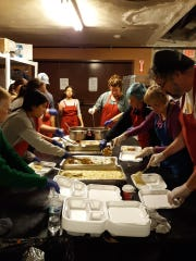 Volunteers with Harvest of Hope prepare meals for Thanksgiving Day 2019.
