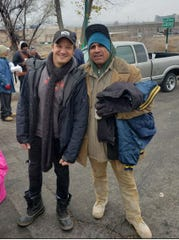 Actor Jeremy Renner is pictured with a Reno man receiving help from Harvest of Hope on Nov. 28, 2019.