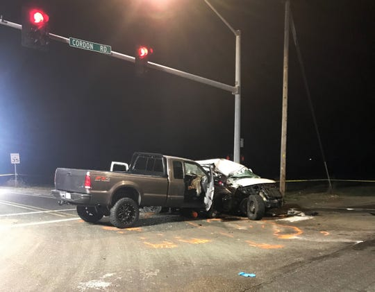 The scene of a fatal crash on Cordon Road NE near Sunnyview RD NE. The crash involved a Ford F-350 and a Chevy passenger van.