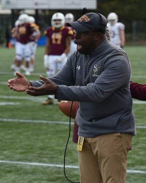 Salisbury University head coach Sherman Wood talks with an official on Saturday, Nov. 30, 2019.