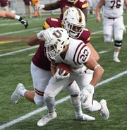 Salisbury University linebacker Pat Bernardo tackles Union's Griff Wallner on Saturday, Nov. 30, 2019.