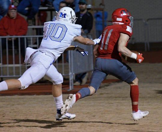 Haughton's CJ McWilliams scores a touchdown against Mandeville in an LHSAA Class 5A quarterfinal playoff game.