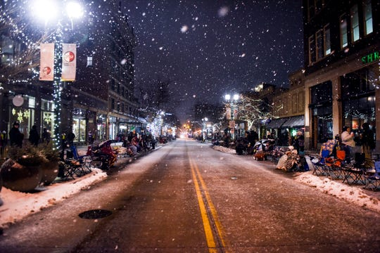 Snow falls before the 28th annual Parade of Lights on Friday, Nov. 29, 2019 in downtown Sioux Falls, S.D.