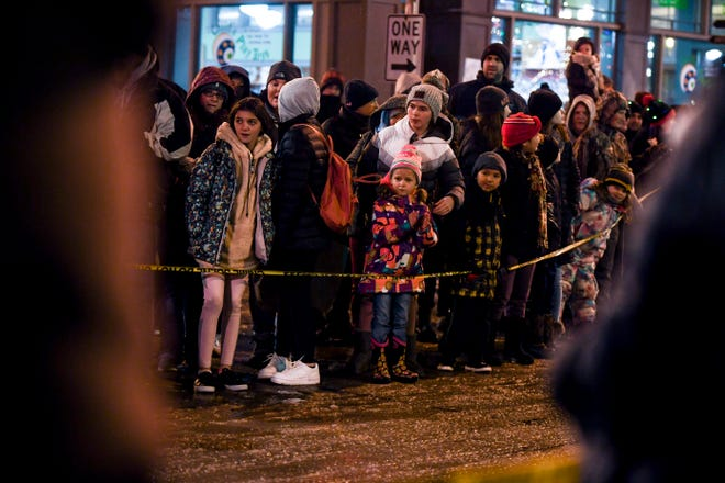People gather to watch the 28th annual Parade of Lights on Friday, Nov. 29, 2019 in downtown Sioux Falls, S.D.