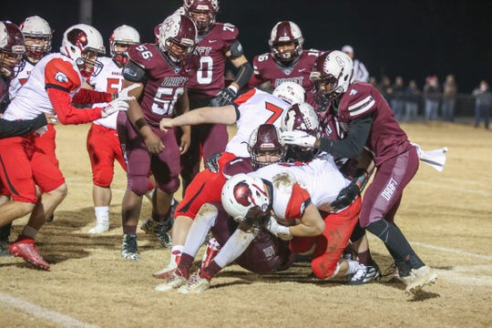 Draft's defense stops East Rock's Trenton Morris (5) at Stuarts Draft High School in Stuarts Draft on Friday, November 29, 2019.