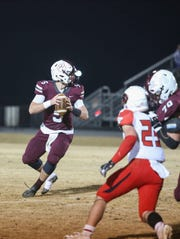 Quarterback Henry Cooke (5) looks for an open man to pass to at Stuarts Draft High School in Stuarts Draft on Friday, November 29, 2019.