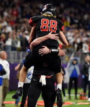 ROCORI senior Andrew Anderson hugs quarterback Jack Steil after catching the winning pass in overtime in the Class 4A state championship, Friday, Nov. 29, 2019, at U.S. Bank Stadium. Both were honored Monday as North Central White Division players.