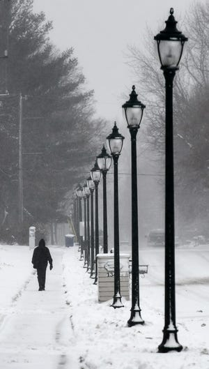Snow continues to fall throughout the morning Saturday, Nov. 30, 2019, in St. Cloud. The National Weather Service declared a winter storm warning for the St. Cloud area through noon Sunday.