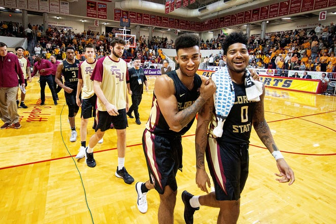 Florida State guards Anthony Polite (2) and Rayquan Evans (0) celebrate after defeating Tennessee in an NCAA college basketball game at the Emerald Coast Classic in Niceville, Fla., Friday, Nov. 29, 2019. (AP Photo/Mark Wallheiser)