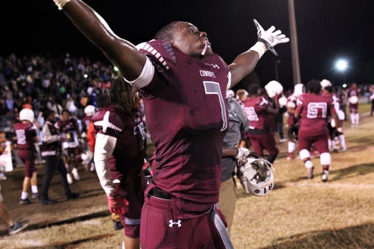 Madison County senior defensive end Demarvion Brown celebrates as the Cowboys beat Pahokee 37-36 in a Class 1A state semifinal at Boot Hill Stadium on Nov. 29, 2019.