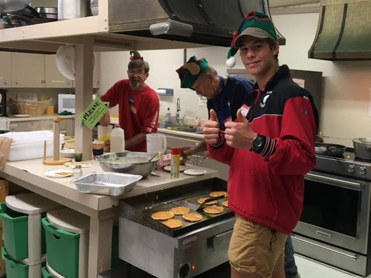 Elves are at work for Breakfast with St. Nicholas as Episcopal Church of the Advent.