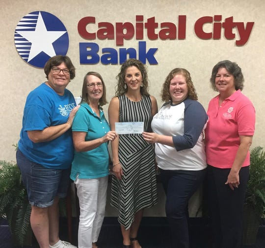 Capital City Bank Group Foundation for selecting the Pilot Club of Tallahassee to receive a $1,000 grant.