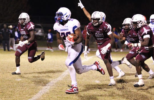 Pahokee senior running back Corey Polk runs for his fourth touchdown, but Madison County beat Pahokee 37-36 in a Class 1A state semifinal at Boot Hill Stadium on Nov. 29, 2019.