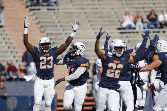 UTEP celebrates after Praise Amaewhule recovered a fumble for a touchdown in Saturday's game against Rice at the Sun Bowl