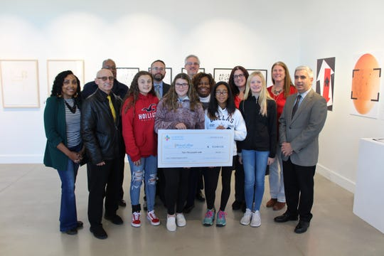 Lakeside Middle School students Gabriella Jacquet, Isabella Musey, Luciano Lewis and Ashlee Zimmerman (center), part of the first cohort of students to participate in the STEAM program supported by the Corning Incorporated Foundation, are joined by officials from the county Freeholder Board, Corning, Rowan College of South Jersey-Cumberland, and Millville Public Schools to kick off the start of the enrichment initiative, which was made possible by the foundation's donation.