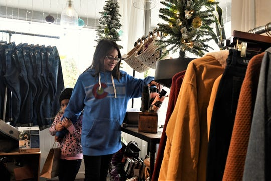 Jenna Garvin, 11, and sister Charleigh Casares, 4, shop at Joshua Tree in downtown Visalia on Small Business Saturday.