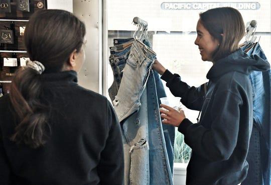 Anushka and Kiran Larson shop at Joshua Tree in downtown Visalia on Small Business Saturday.