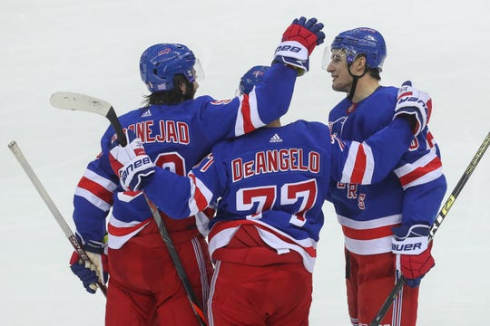 Nov 30, 2019; Newark, NJ, USA; The New York Rangers celebrate a goal by New York Rangers defenseman Brady Skjei (76) during the third period at Prudential Center. Mandatory Credit: Ed Mulholland-USA TODAY Sports