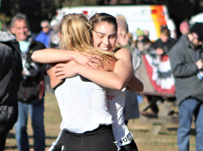 North Rockland's Katelyn Tuohy embraces teammate Haleigh Morales after she qualified for the 2019 Nike Cross Nationals.