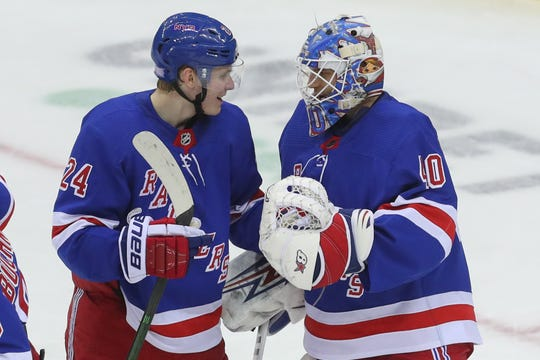 Nov 30, 2019; Newark, NJ, USA; New York Rangers right wing Kaapo Kakko (24) and New York Rangers goaltender Alexandar Georgiev (40) celebrate the New York Rangers 4-0 win over the New Jersey Devils at Prudential Center. Mandatory Credit: Ed Mulholland-USA TODAY Sports