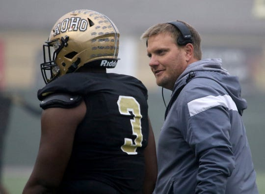Rider head football coach Marc Bindel talks with AJ Sargent Friday, Nov. 29, 2019 in the Class 5A Division I regional semifinal against Wichita Falls High in Memorial Stadium. The Raiders defeated the Coyotes 56-20.