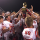 Holliday's players celebrate after the team beat Lexington on Nov. 29 in a regional playoff game in Burleson.