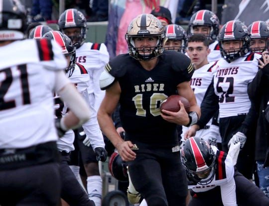 Rider's Jacob Rodriguez runs along the sideline against Wichita Falls High Friday, Nov. 29, 2019 in the Class 5A Division I regional semifinal in Memorial Stadium. The Raiders defeated the Coyotes 56-20.