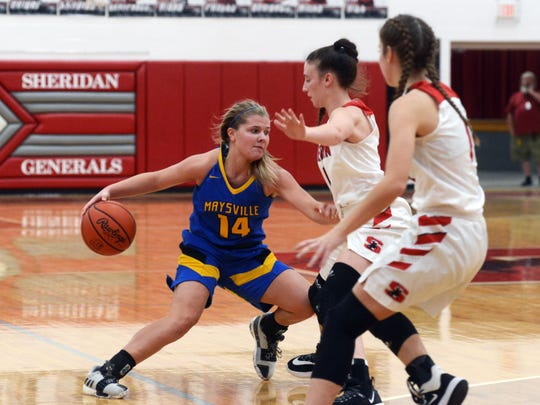 Bailee Smith, of Maysville, looks for driving room against Sheridan's Grace Conrad.