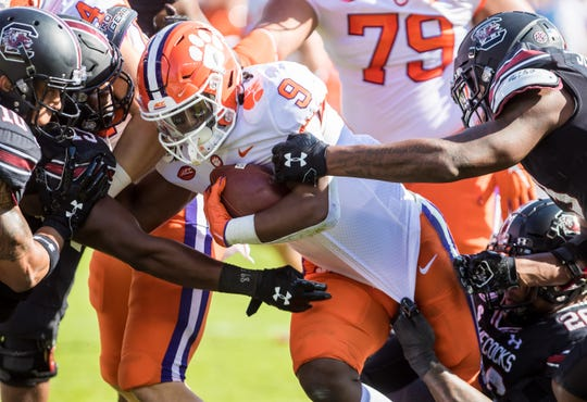 Clemson running back Travis Etienne carries the ball during the first half against South Carolina at Williams-Brice Stadium.