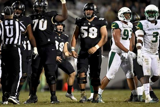 University of Central Florida Knights place-kicker Dylan Barnas (39) of Merritt Island reacts after kicking a 50-yard field goal during the second quarter against the South Florida Bulls at Spectrum Stadium.