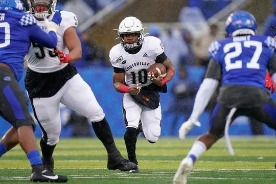 Louisville running back Javian Hawkins (10) rushes for some of his 142 yards against Kentucky, Saturday, Nov. 30, 2019, in Lexington, Ky.