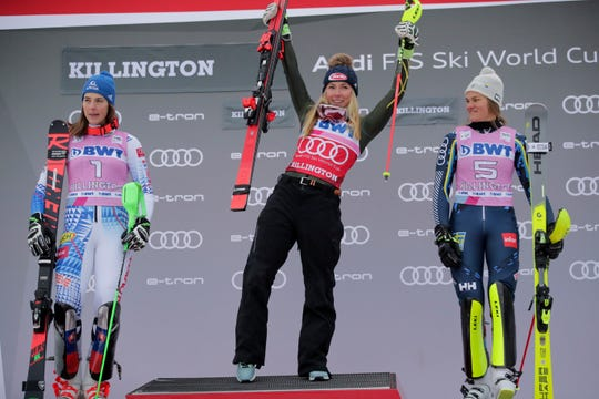 United States' Mikaela Shiffrin, center, winner of an alpine ski, women's World Cup slalom, poses on the podium with second placed Slovakia's Petra Vlhova, left, and third placed Sweden's Anna Swenn Larsson, in Killington, Vt., Sunday, Dec.1, 2019.