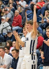 Adena's Logan Bennett and teammate Preston Sykes celebrate during a 73-41 win over Lucasville Valley in Frankfort, Ohio, on Saturday, November 30, 2019.