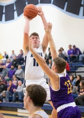 Adena basketball's Logan Bennett shoots the ball in a 73-41 win over Lucasville Valley in Frankfort, Ohio, on Saturday, November 30, 2019.