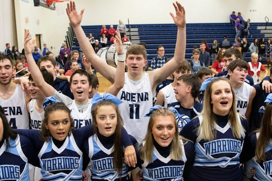 Adena's Logan Bennett celebrates with teammates and classmates after a 73-41 win over Lucasville Valley in Frankfort, Ohio, on Saturday, November 30, 2019.