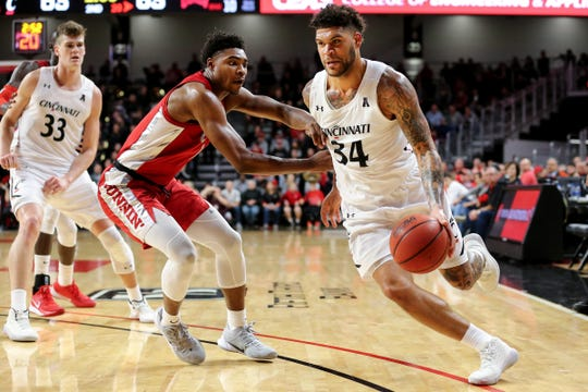 Cincinnati Bearcats guard Jarron Cumberland (34) drives to the basket as UNLV Rebels guard Bryce Hamilton (13) defends in the second half of a college basketball game, Saturday, Nov. 30, 2019, at Fifth Third Arena in Cincinnati.