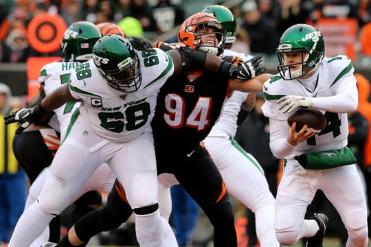 Cincinnati Bengals defensive end Sam Hubbard (94) applies pressure on New York Jets quarterback Sam Darnold (14) as New York Jets offensive tackle Kelvin Beachum (68) tries to hold him back during the fourth quarter of a Week 13 NFL game, Sunday, Dec. 1, 2019, at Paul Brown Stadium in Cincinnati. The Cincinnati Bengals won 22-6, and improved to 1-11 on the season.