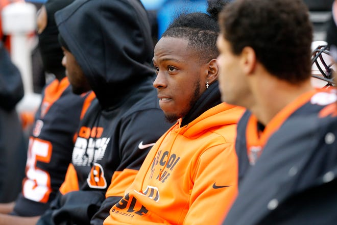 Injured Cincinnati Bengals wide receiver John Ross (11) sits on the bench in the second quarter of the NFL Week 13 game between the Cincinnati Bengals and the New York Jets at Paul Brown Stadium in downtown Cincinnati on Sunday, Dec. 1, 2019. The Bengals led 17-6 at halftime.