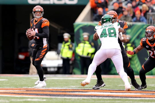 Cincinnati Bengals quarterback Andy Dalton (14) drops back to throw during the first quarter of a Week 13 NFL game against the New York Jets, Sunday, Dec. 1, 2019, at Paul Brown Stadium in Cincinnati.