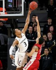 Cincinnati Bearcats guard Mika Adams-Woods (3) blocks a shot on UNLV Rebels guard Elijah Mitrou-Long (55) in the second half of a college basketball game, Saturday, Nov. 30, 2019, at Fifth Third Arena in Cincinnati.