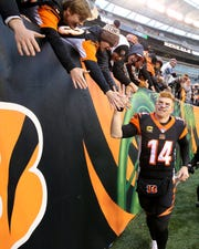 Cincinnati Bengals quarterback Andy Dalton (14) celebrates after the fourth quarter of a Week 13 NFL game against the New York Jets, Sunday, Dec. 1, 2019, at Paul Brown Stadium in Cincinnati. The Cincinnati Bengals won 22-6, and improved to 1-11 on the season.