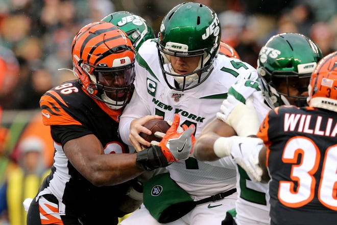 Cincinnati Bengals defensive end Carlos Dunlap (96) sacks New York Jets quarterback Sam Darnold (14) during the fourth quarter of a Week 13 NFL game, Sunday, Dec. 1, 2019, at Paul Brown Stadium in Cincinnati. The Cincinnati Bengals won 22-6, and improved to 1-11 on the season.